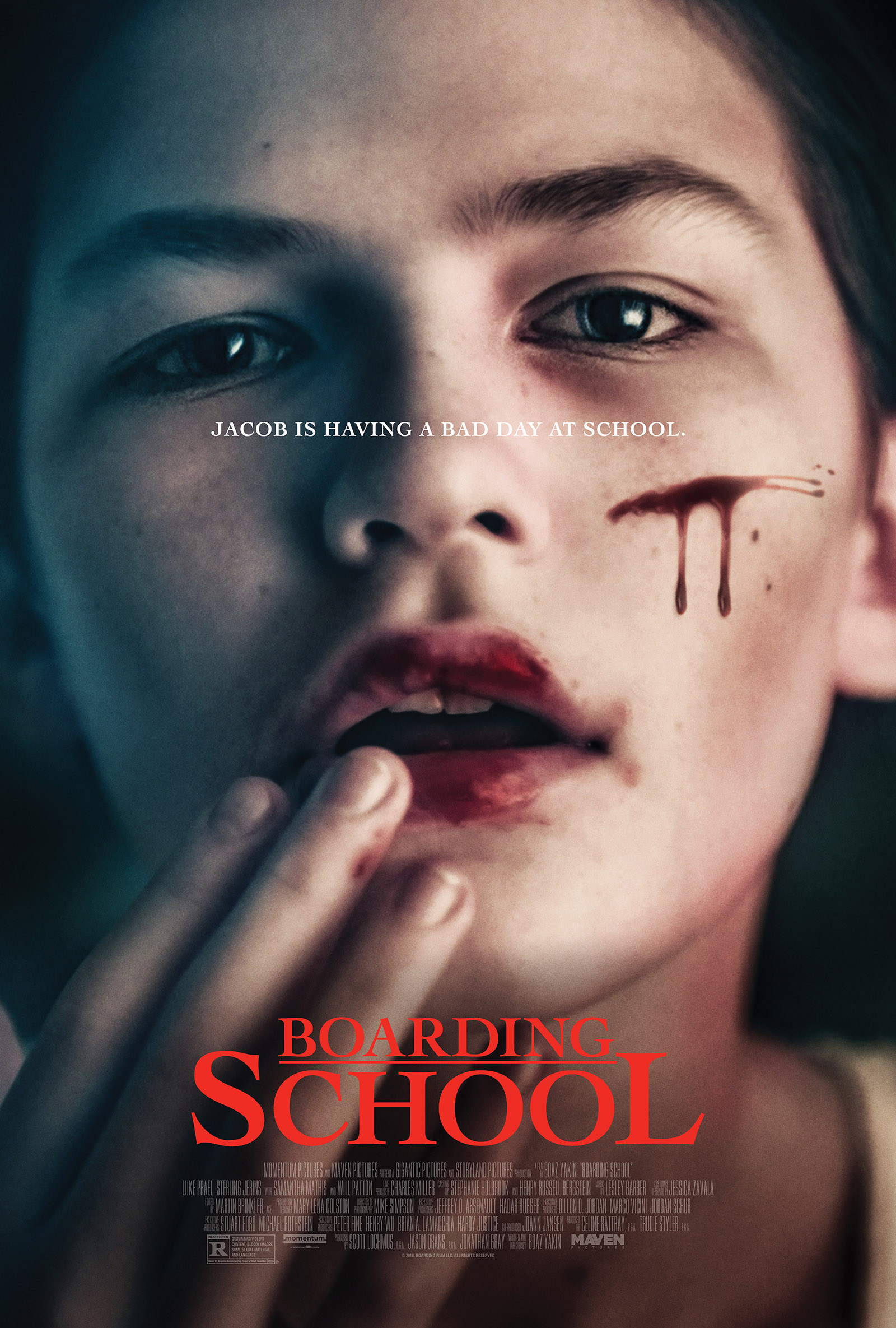 Movie poster with a pale young boy with blood on his lips and cheek, holding his fingers to his lips with his mouth open. The poster text reads'Jacob is having a bad day at school.', with the movie title appearing in red below his face.